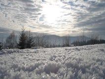 Winter sun. A winter sun among mountains Royalty Free Stock Photos