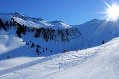 Winter sun in Alps Stock Images