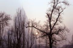 Winter sun glimpse through smog in Urumqi. Glimpse of winter sun through heavy smog in Urumqi, China Royalty Free Stock Photo