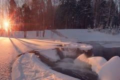 Winter sun illuninate small waterfall Stock Images