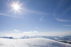 Winter Sun in mountain. In snow winter Royalty Free Stock Photo
