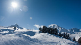 Winter sun in mountains Stock Photo