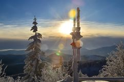 Winter sun in mountains. Winter mid-morning trail in mountains stock photo