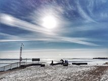 Winter Sun over the Baltic sea off the coast of Helsinki, Finland. In winter, there is a beautiful scene where the sun is bright in the sky. The sky is blue stock photo