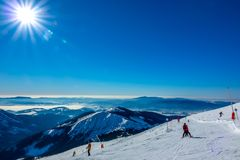 Winter Sun Over Mountain Peaks And Ski Run Stock Images