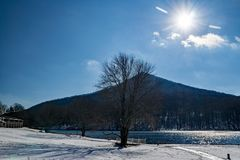 Winter Sun Over Sharp Top Mountain. With Abbott Lake in foreground located at the Peaks of Otter, Blue Ridge Parkway, Bedford County, Virginia, USA Royalty Free Stock Images