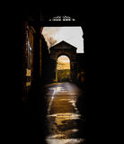 Winter sun view through silhouette archway Royalty Free Stock Image