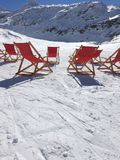 Winter sunbathing. Deck chairs in the snow Royalty Free Stock Image
