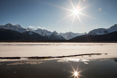 Winter Sunburst Reflections Royalty Free Stock Photography