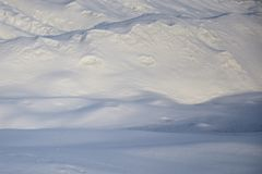 Snow drifts in a winter sunny day royalty free stock photography
