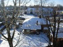 Winter sunny day in the town. Winter sunny day town wood house little houses landscape landscapes Bobruisk Belarus trees blue snow sky yard courtyard Birch Royalty Free Stock Photo