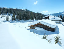 Winter sunny mountain and wood house Stock Image