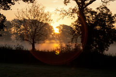 Winter Sunrise. Sunrise on a cold winter morning, with mist rising from the fields Stock Image
