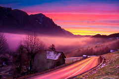 Winter sunrise. In the mountains with an icy road Stock Photo