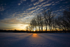 Winter Sunrise. A sunrise in winter, sparkling ice and frigid, crisp sky Royalty Free Stock Photography