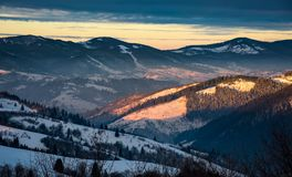 Winter sunrise in Carpathian mountains. Beautiful landscape with snowy hillsides Royalty Free Stock Image