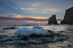 Winter sunrise on the coast of the icy sea. East Sea. Stock Photography
