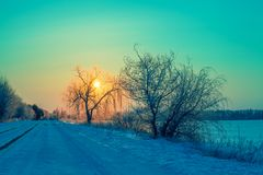 Winter sunrise in the countryside. The road to sunrise royalty free stock photos