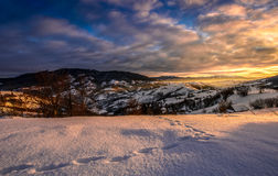 Winter sunrise in mountainous rural area Stock Photos