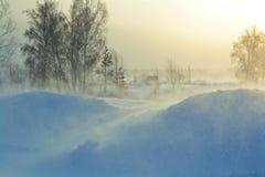 Winter Sunrise. Orange Sun rises over the village in the winter Royalty Free Stock Image