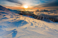 Winter sunrise over the clouds Stock Photo