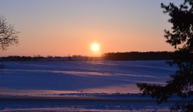 Winter sunrise over field royalty free stock photography
