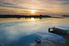 Winter Sunrise over a Glassy River with Boat and J Stock Photography