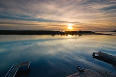 Winter Sunrise over a Glassy River with Boat and J Royalty Free Stock Photos