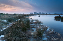 Winter sunrise over river Stock Image