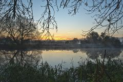 Winter sunrise over a river in Cambridgeshire UK Stock Photo
