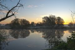 Winter sunrise over a river in Cambridgeshire UK Stock Image