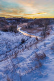 Winter sunrise over the valley covered with snow Royalty Free Stock Photos
