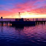 Winter sunrise in Port Albert, Victoria, Australia. Port Albert, fishing village. Once way Gippsland largest Port. A winter sunrise as one of the fishing boats Stock Photo