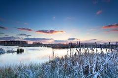 Winter sunrise on river Stock Photo