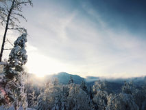 Winter sunrise in Smuggler's Notch, Vermont. Looking eastward toward the mountains near Smuggler's Notch in Vermont in wintertime. The sun is rising and Royalty Free Stock Photo