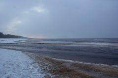 Winter sunrise snow baltic beach, latvia, saulkrasti. Winter nature landscape. Sunset over frozen sea latvia stock photo