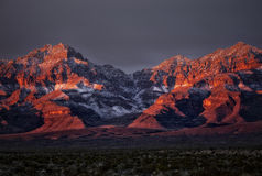 Winter Sunrise on snow dusted mountains Royalty Free Stock Image