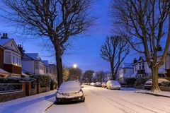 Winter sunrise in snowy suburb in London. UK Stock Photography