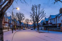 Winter sunrise in snowy suburb in London. UK Stock Images