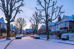 Winter sunrise in snowy suburb in London. UK Royalty Free Stock Photo