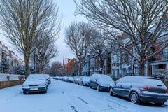 Winter sunrise in snowy suburb in London. UK Stock Image