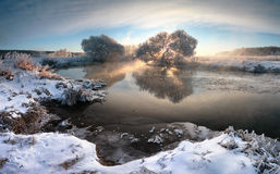 Winter brightness. Beautiful winter sunrise over river. Stitched panorama Royalty Free Stock Images