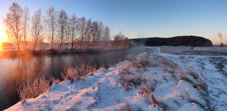 Winter morning. Beautiful winter landscape on the river Stock Photos