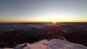 Winter sunrise time-lapse from the top stock video footage