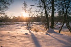 Winter sunrise. Winter river. Cold winter morning. Winter sunrise in Belarus. Cold winter morning. Winter river Stock Images