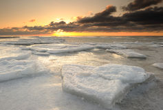 Winter Sunset. Frozen sea at sunset with nice clouds Stock Photography