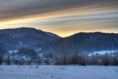 Winter sunset. Sunset over a village in the mountains during winter stock image