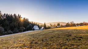 Winter sunset. Sunset above huts in Czech republic stock images