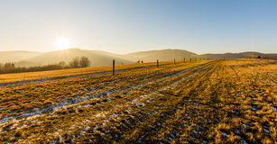 Winter sunset. Sunset above mountains in Czech republic stock photo