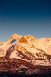 Winter sunset on the Arche peak in the Ecrins National Park (Hautes Alpes). France. Winter sunset on the Arche and Aiguille peaks covered in snow in Ecrins Stock Photography